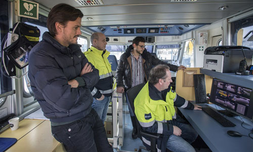 Men on board the Floating Lab in Rotterdam harbor